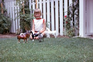 That's me with my Breyer plastic horses in Grandfather's back yard
