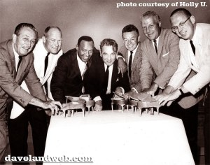 That's Dad, Bill Elliott (Ulyate) next to Walt Disney, Uncle Lloyd, also in white coat, with Music Greats (Les Brown).