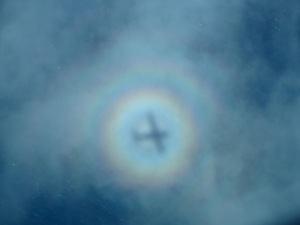 Circular Rainbow –  known as a Glory – made by an airplane when the shadow hit a cloud flying en route Honolulu to Molokai 2014 :))